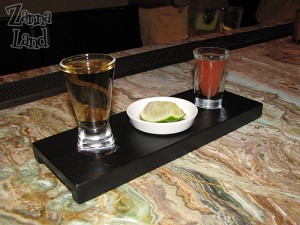Tequila shot served with Sangrita, lime and salt