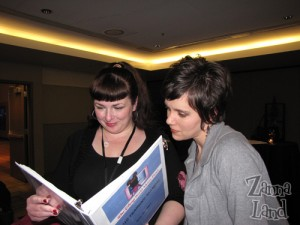 Disney Mom's Amy R. and Amanda W. reading our training binder.