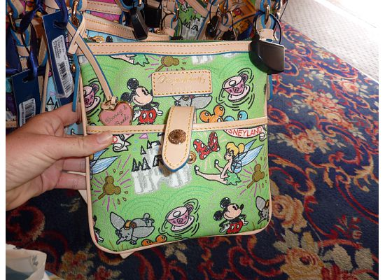 Disney Dooney and Bourke Green Letter Carrier