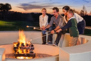 Family at Firepit at Hyatt Regency Grand Cypress 2014 SMALL